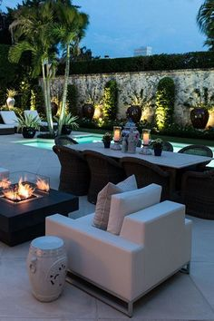 """Contemporary Patio with Fire pit, 42"""" x 42"""" Square Modern Concrete Fire Pit Table in Brown, Aloe Vera Medicine Plant, Fence"""