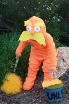 Rachelle: My 18 month old son Jake makes a perfect Lorax. His grandmother made this costume at my request. It is made from orange fleece. Details on the hat include yellow...
