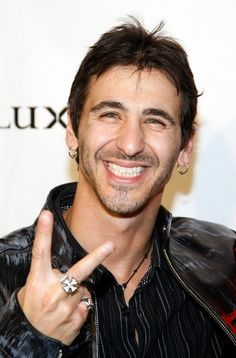 My bad boy crush ~ Sully Erna from Godsmack. I love the band too :)