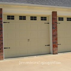 faux painted garage door makeover for about $25.00   Much more interesting than a old plain white door!