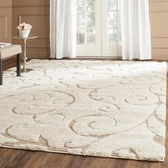 This power-loomed shag rug offers luxurious comfort and unique styling with a raised high-low pile. High-density polypropylene pile features a cream background with beige accents and provides one of the most plush feels available in a rug.