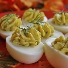 Hard-cooked eggs are stuffed with a creamy blend of mayonnaise, Dijon mustard and rice wine vinegar. Fresh dill and garlic powder add a delightful flavor.