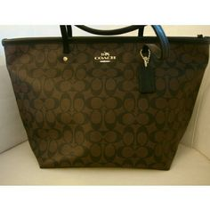 Authentic Coach Zip Tote Brand: Coach Color: Black/ Brown  Dimensions: 17 inches (length) x 10 inches (height) x 7 inches (depth)  1 inner zipper compartment & 2 inner sleeve compartments  Coach New York engraved hardware  Fully lined interior  Full Zipper closure  Water repellent fabric  Style : Tote    BRAND NEW Coach Bags Totes