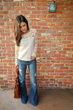 lace shoulders and sleeves... bell bottom jeans.. .casual yet it has attitude