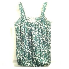 """BANANA REPUBLIC Sleeveless Tank Sleeveless satiny-feeling green & white blouse. The splattered floral design on this blouse is complemented by soft pleating at the top. Only worn a few times. Measurements laying flat: Bust - 17"""" Length - 18.5"""" Banana Republic Tops Blouses"""