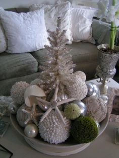 Large bowl centerpiece in silver and white with tree, ornaments and starfish