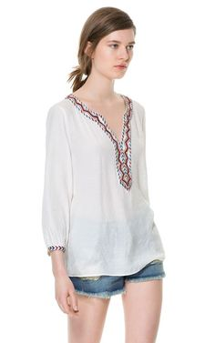 Image 1 of BLOUSE WITH EMBROIDERED NECKLINE from Zara