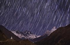 A time lapse photograph of the Himalayas and the night sky showing the rotation of the Earth