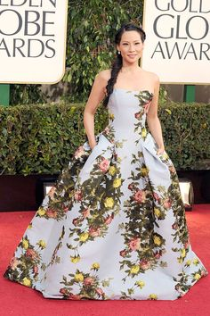 Lucy Lui at the Golden Globes 2013  stuns in an unexpected floral Carolina Herrera strapless gown.