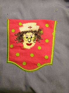 Machine embroidery on appliqué pocket