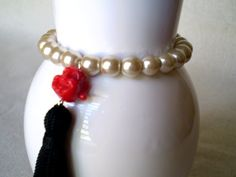 Cream glass pearl stretch bracelet with Happy Buddha by MyleneV, $10.00