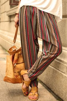 Bohemian Striped Harem Pants will give you classy look. take comfy footwear and a sleek tote!