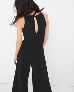 """Chic matte jersey jumpsuit designed with cutaway shoulders, wide flowing legs and a choice of two removable sashes: matte black or sparking sequins.    Slightly loose stretch fit.   Front and back keyholes, a button-and-loop closes the back.   Includes two sashes. Thread loops at waist.   Lined bodice.    95% Polyester, 5% Spandex. Machine wash. Imported.     32.5"""" inseam."""