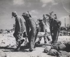Wounded US Marine being evacuated from Tarawa, Gilbert Islands, Nov 1943