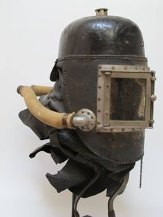 Fireman's Smoke Helmet by Siebe Gorman & Co early helmet of leather with pair of hinged windows with mica panes. Hoses connect to the helmet and a second person would pump air in with a bellows for fire rescue. A survivor. R Robot, Steampunk Armor, Ww1 History, Fire Helmet, Scuba Diving Equipment, Military Pictures, Alternate History, Fantasy Weapons, Post Apocalyptic