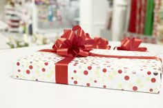 Gift Wrap Wonderland at The Container Store - Learn how to wrap the perfect gift and make your own bows!