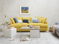 Meet the Swiss Army knife of the coffee table world. We've stashed two squishy linen footstools under our Caboodle to make loafing lovelier in a small space. Living Room Sofa, Home Living Room, Room Colors, House Colors, Chaise Chair, Yellow Sofa, Comfy Sofa, Furniture Showroom, Modular Sofa