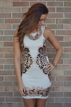 This dress will be available online very soon!