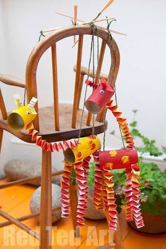 """TP Roll Marionettes - Giraffes - From old TP rolls to dancing giraffe marionettes! A fabulous book & craft activity to go with the story """"Giraffes can't dance"""". Love this loo roll upcycle and that you create such a fabulous toy!"""