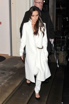 Victoria Beckham - The designer is cause for a double take in a all white look complete with trousers and a killer coat.