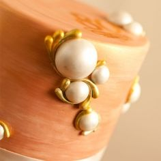 Edible pearls with gold accents...fondant in measuring spoons! Check out video at kveloria