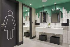 white subway tile and green accent sin the bathroom at a retro hotel in Rio de Janeiro