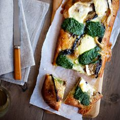 Eggplant, Pesto, and Goat-Cheese Pizza | Tangy goat cheese, sharp Parmesan, tender sautéed eggplant, and bold pesto cover a mouth-watering pizza. This recipe makes a hearty fourteen-inch pizza; you be the judge whether it serves two or four.