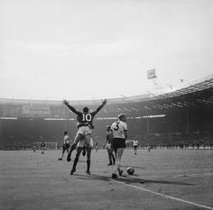 Geoff Hurst celebrates with a team mate during the 1966 World Cup Final at Wembley Stadium, July The score stands at and England won the game after extra time. Consigue fotografías de noticias de alta resolución y gran calidad en Getty Images School Football, Football Soccer, Football Players, Fifa, Football Mondial, 1966 World Cup Final, Geoff Hurst, Foto Sport, Bristol Rovers