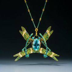 A stunningly beautiful gold, diamond and enamel dragonfly pendant by René Lalique, the undisputed genius of Art Nouveau jewellery. This signed piece made c1903 depicts four dragonflies with green-blue enamelled legs and wings with a large oval acquamarine in its centre. - Epoque Fine Jewels
