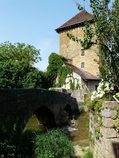 The old packhorse bridge and Gloriette Tower in Arbois, France