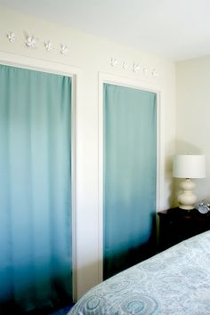 Who needs closet doors. Use pretty fabric and tension rods to hide the stuff and add color.