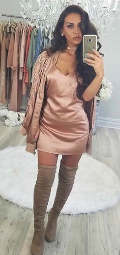 Carlibybel Style wearing a sexy fall outfit idea with a rosegold bomber jacket and thigh high boots super cute look.