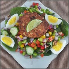 Yummy clean eat before evening beastmode. Fresh wild atlantic salmon cake seasoned with lime, cilantro, and ground pepper...over a bed of crisp baby spinach topped with jalapeno, raw pecans, mixed peppers, red onion, egg and salad cucumbers