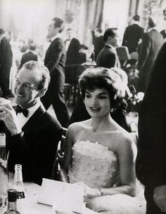 Such an amazing photograph.  LOVE her dress. LOVE that she is sitting next to David Niven.