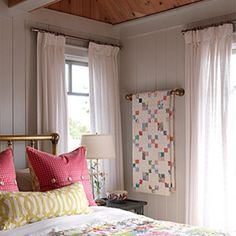How to display quilts. Like this idea for the bedroom.