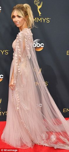 Once upon a time: The 42-year-old looked like she had stepped out of a fairy-tale in a delicate pink gown