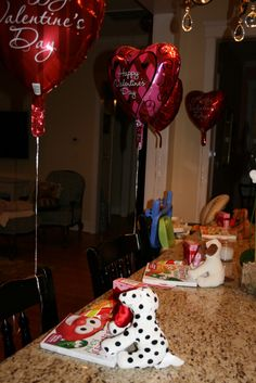 Valentines morning for kids - I love the balloons at their chairs.( my dad used to do this!!! Love him! )