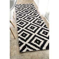 Found it at Wayfair - Kellee Black Area Rug - would look great if we did a black floor and white cabinetry