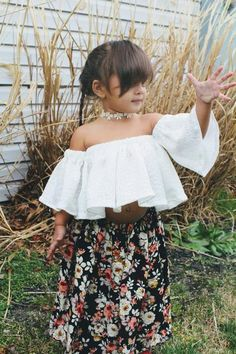 White lace toddler shirt to show those beautiful shoulders, a unique open back blouse to make stunning outfits for girls. Long wide sleeves on a clean cut lace