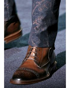 Gucci brown wingtip boots.