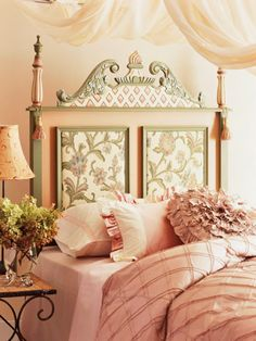 so beautiful! ♥ the subdued sage and cream and petal pink ... and the framed fabric headboard with its archectural detailing!