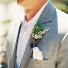 herb boutonniere with silver arsenal pin