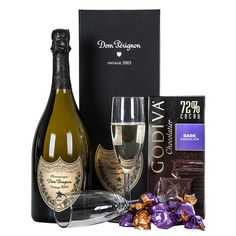 Celebrate with Dom Perignon A beautifully boxed vintage 2005 bottle of Dom Perignon combined with two champagne flutes, Godiva Chocolate Truffles and Godiva Dark Chocolate Bar. Cheese Gift Baskets, Cheese Gifts, Gourmet Gift Baskets, Gourmet Gifts, Champagne Gift Baskets, Housewarming Gift Baskets, Gift Baskets For Women, Fruit Gifts, Dom Perignon