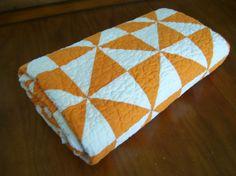Happy Pinwheel Quilt - Orange\/White. via Etsy.