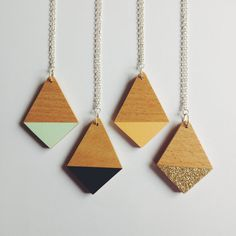 Simple and chic, this necklace shows of the natural beauty of the lovely beech plywood its made with, with a pop of colour at one end. Made from - The diamond has been hand cut and shaped from beautiful beech plywood, with either black, mint, peach or gold gitter card at one end to give