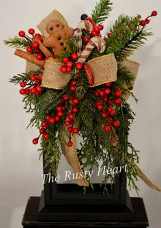 This gingerbread swag is listed in Country Sampler Magazine, and is decorated with various greens, berries, apple slices, candy canes, and burlap