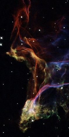 Veil Nebula, part of a large supernova remnant called the Cygnus Loop. Different colors correspond to different wavelengths of light.