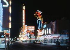 Downtown Vegas, June 1966 Lucky casino, Vegas Vic. In the distance, Four Queens on their opening week. Ektachrome slide, scan by VLV.