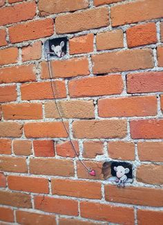 """On the Line"". Kerrytown Market & Shops of Ann Arbor, Michigan (June 21, 2013) - street art by David Zinn"