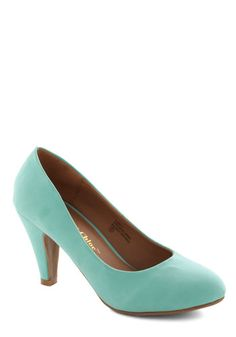 In a Classic of Its Own Heel in Mint. Many shoes have eye-catching patterns or flirty designs, but sometimes the most basic pumps - like these green heels - can become your very favorite. #mint #modcloth